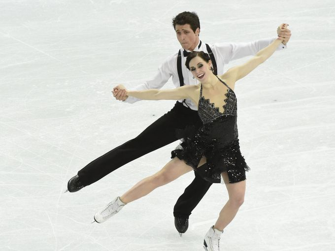 2010 gold medalist ice dancers Tessa Virtue and Scott Moir perform their short program at the 2014 Olympics in Sochi, Russia.