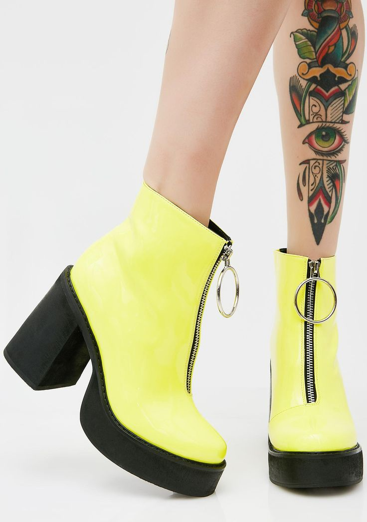 Current Mood Neon Franky Platform Boots got ya feelin' sweet N' sour. These bright yellow boots have black platform soles, chunky heels, and a front zipper closure with a big azz o-ring pull.
