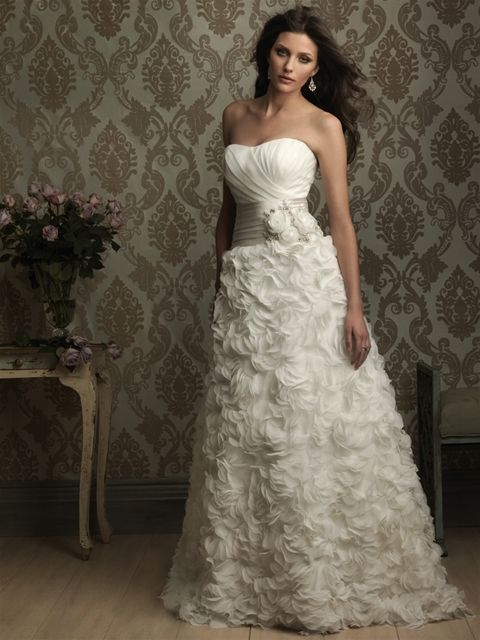 Allure Bridals: Style: 8855. This gown features three-dimensional details to create a romantic look. The strapless bodice is ruched and accented with a satin band with rose and crystal accents.