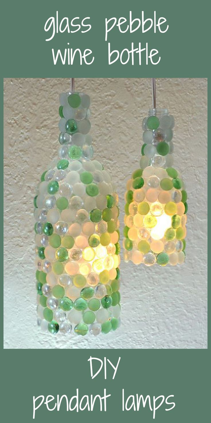 Another amazing wine bottle upcycle. I love how the light hits the glass pebbles. So pretty!