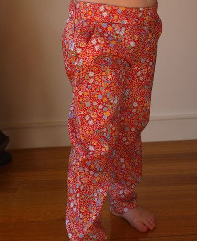 Tout Petit designed and mande Liberty Tana Lawn Kayoko Red pants with elasticised waist. 100% Tana Lawn cotton, made in Denmark. These pants are super smart, with pockets, straight cut and look great when rolled up at the bottom.  Sizes 2, 4, and 6 $109.95