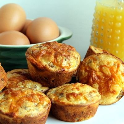 Sausage and Cheese Muffins.               ½ pound ground pork sausage, cooked & drained   1 cup Bisquick   1/3 cup sour cream   1/2 cup sharp cheddar cheese, shredded (plus extra for sprinkling on top)   2 large. eggs, lightly beaten   2/3 cup whole milk   salt and pepper to taste