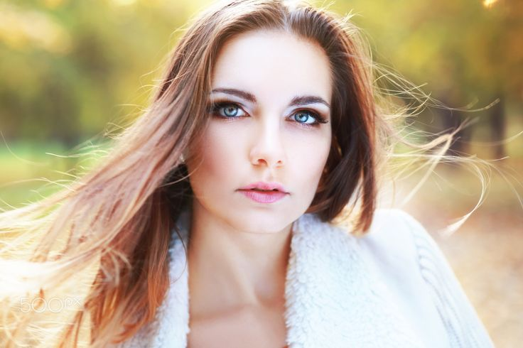 outdoors fashion portrait - Young woman outdoors fashion portrait. Soft sunset light