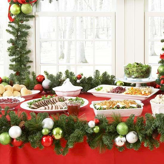 Add Festive Greenery to a Buffet Spread  Get Christmas party guests into the holiday spirit with a decked-out buffet table. Cover the table with a deep red tablecloth and line the edge with a leafy garland with red, green, and silver ornaments.