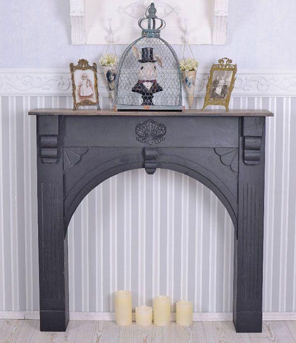 czarna obudowa kominkowa w stylu vintage