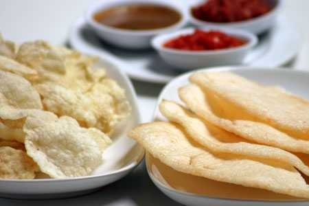 Kerupuk~ Deep fried crisps made from mainly tapioca flour, with added ingredients, such as prawn, fish, or garlic, and even ox/cow skin. It comes in different shapes and colors.