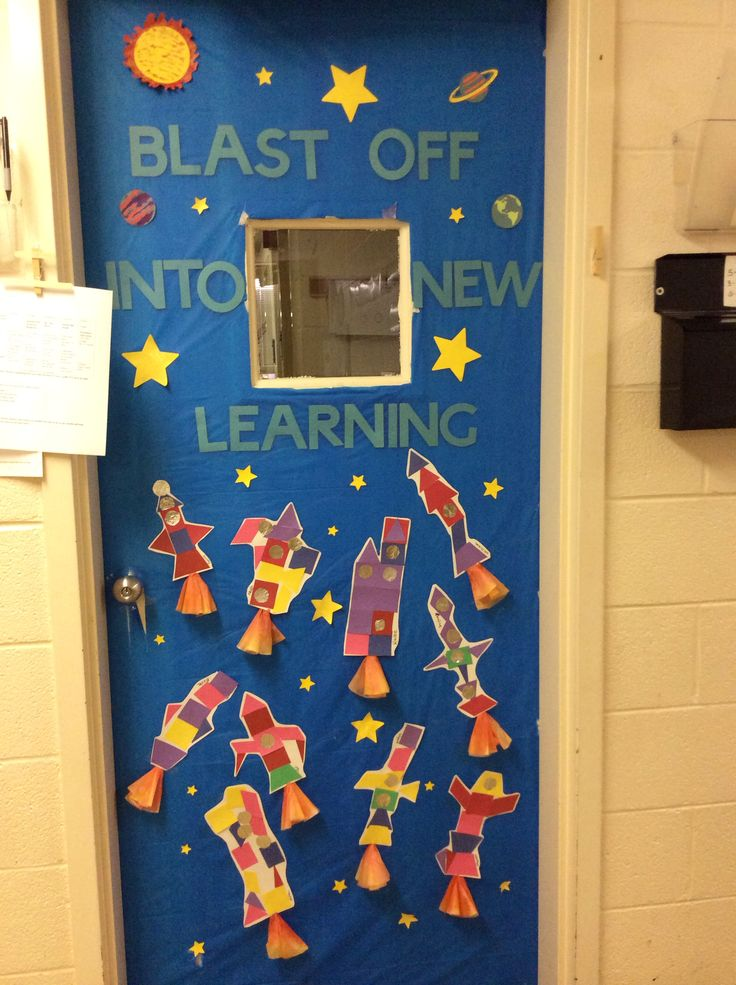 Space themed door decoration preschool bulletin boards for Nursery class door decoration