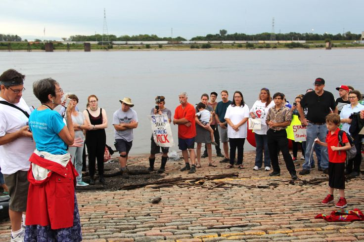 """Alaskan Native Laura Belarbi, a member of the Ethical Society of St. Louis, sang a song from her childhood at the event. """"I think the project just sounds so crazy, like I can't believe it's actually happening,"""" she said. - St. Louis residents, activists and city officials gathered on Sept. 8, 2016, at the Gateway Arch riverfront to express opposition to the Dakota Access Pipeline."""