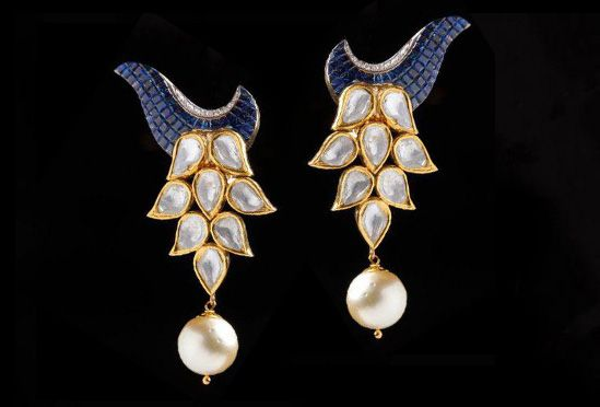 Bridhichand Ghanshyamdas floral earrings with invisible-set blue sapphires and polki diamonds, from the new Adrishya Collection
