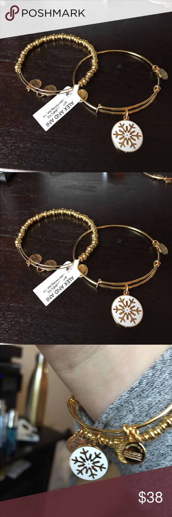 ❣️Rare❣️Alex and Ani shiny gold bracelets Set of two shiny gold Alex and Ani bracelets. One is a shiny gold beaded bracelet and the other is a shiny gold and white snowflake ❄️ truly a beautiful set. New with retail tags Alex & Ani Jewelry Bracelets