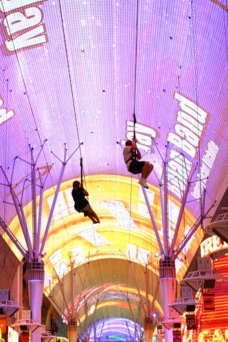 Ziplining down Fremont Street -- As daredevil as I will get in Vegas..don't expect me to get on top of the Stratosphere!