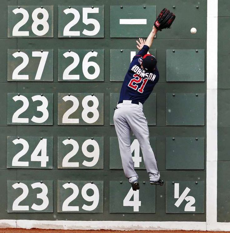 A jump in the standings -        Minnesota Twins left fielder Shane Robinson leaps but can't make the catch on a double by Boston Red Sox designated hitter David Ortiz during the first game of a doubleheader at Fenway Park in Boston on June 3. Boston won the first game 6-3, but dropped the nightcap to Minnesota 2-0 .    -   © Charles Krupa/AP
