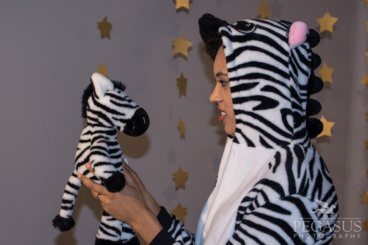 A zebra singing to a zebra on the set of the music video for the song Sing Me to Sleep by Tweed.