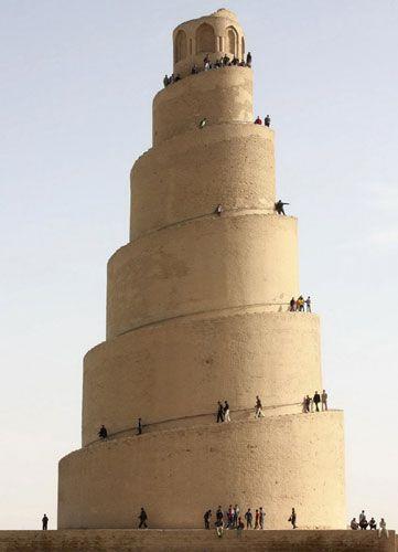 Samarra, Iraq: People visit the Spiral Minaret or ziggurat of the Great Mosque