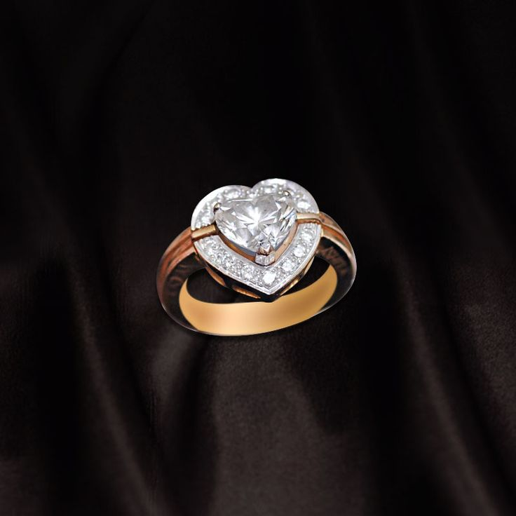 Heart shaped diamond with gold band   Call us now for diamond jewellery, designer jewellery, bridal and semi bridal jewellery on 0124-42000518 to walk in our showroom in Gold souk mall, Gurgaon.  #Diamonds #Diamondjewelry #bridaljewelry #designerjewellery #diamondrings #luxuryjewelry