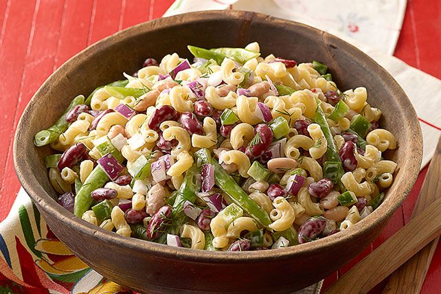 Elbow macaroni, fresh green beans and chopped red onions make this Three-Bean Macaroni Salad as colorful as it is tasty.
