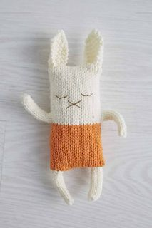 This napping rabbit wears a sweater just like baby. It's knit in stockinette; the sleeping face is embroidered after finishing. The ears and limbs are crafted separately and sewn on.