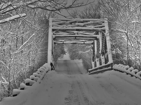 Snow covered bridge crossing the Mad River in Creemore, Ontario, Canada