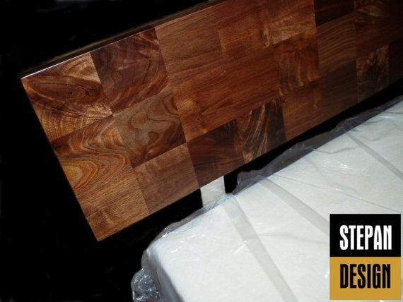Modern platform bed in Walnut (also done in Cherry). The headboard is dramatic, and unique in solid walnut parquet, with pieces selected and a