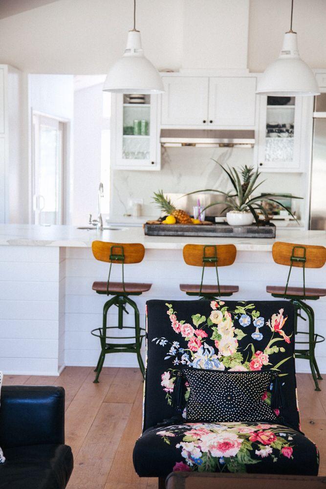 white kitchen, black chairs