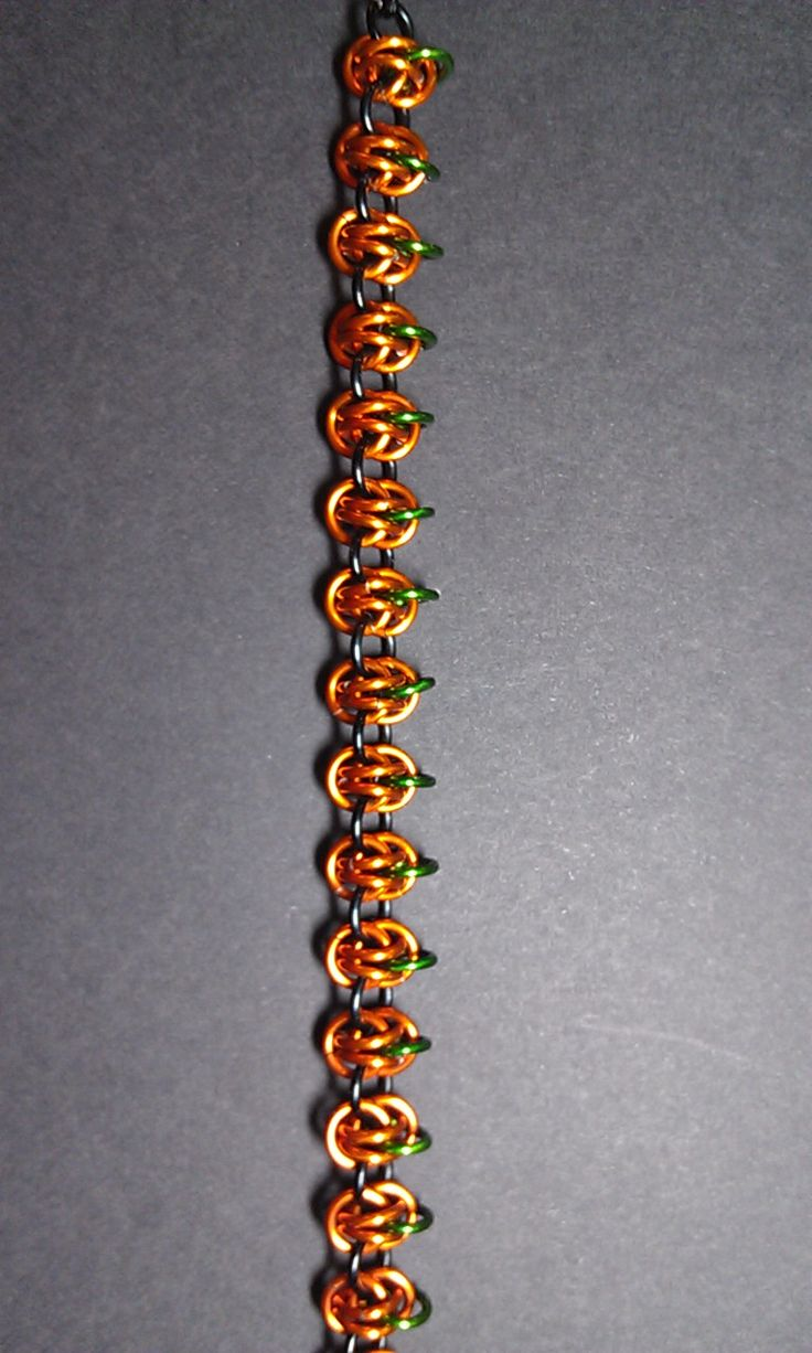 Pumpkin bracelet. A twist on barrel weave. Handmade by TracyH ♥. Chainmaille, chain mail. jump rings, wire jewelry.