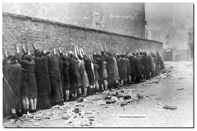 Warsaw Ghetto Uprising, 1943. Jewish fighters lined up against the wall soon to be shot