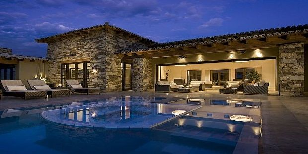 Pool On Side of House