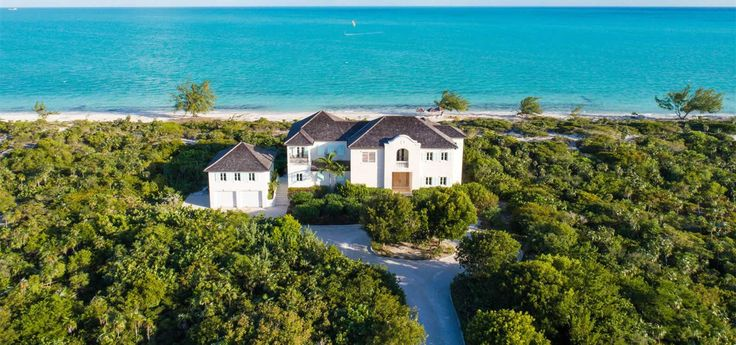 6 bedroom beach house for sale in the Turks & Caicos Islands located right on Long Bay Beach on Providenciales.