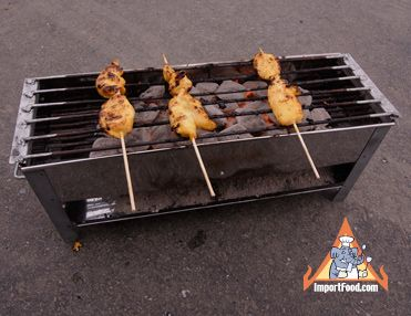 "Thai street vendor satay grill / charcoal.  On sale $22 Importfood.com The grill is 18"" long, 8"" tall, and 6"" wide. Made in Thailand."