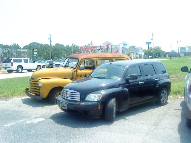 1949 Chevy suburban next to a 2006 HHR