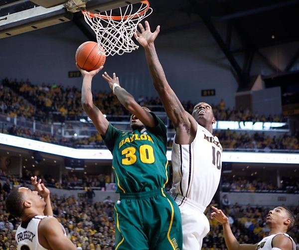 Missouri forward Ricardo Ratliffe attempts to block Baylor forward Quincy Miller in the second half at Mizzou Arena on Saturday, Feb. 11. Photo by Parker Miles Blohm/Missourian