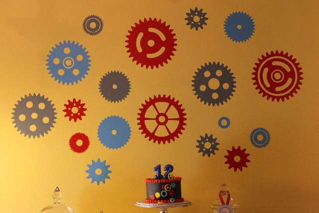 Like the nuts & bolts decorations. Try hanging made from paper plates?