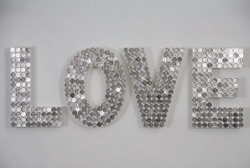wooden letters covered in coins or glass beads. I like the coin
