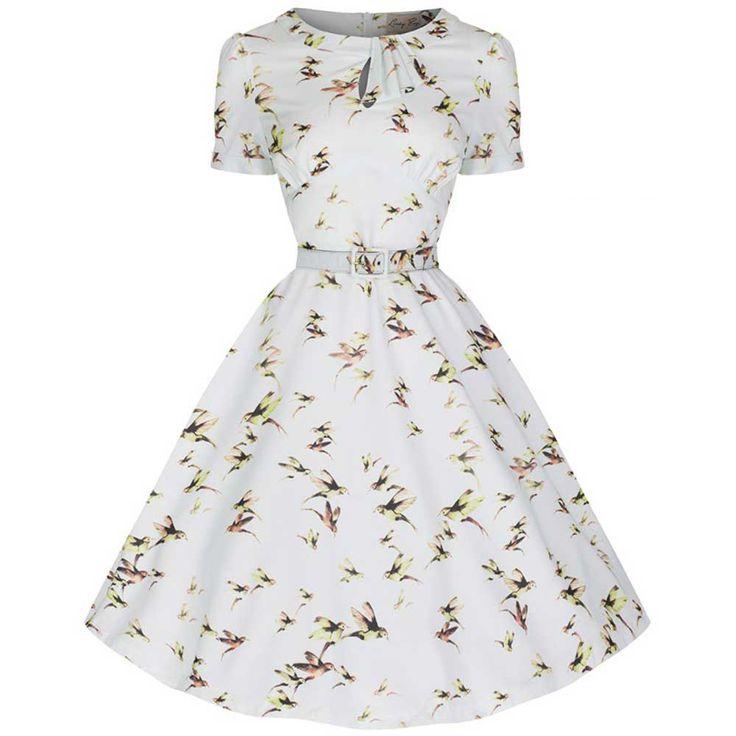 Lindy Bop. Een gele swing jurk met Venice print, wijde schouderbandjes, strik detail, geplooide rok, volledig gevoerd, afneembare riem en ritssluiting aan de achterkant.