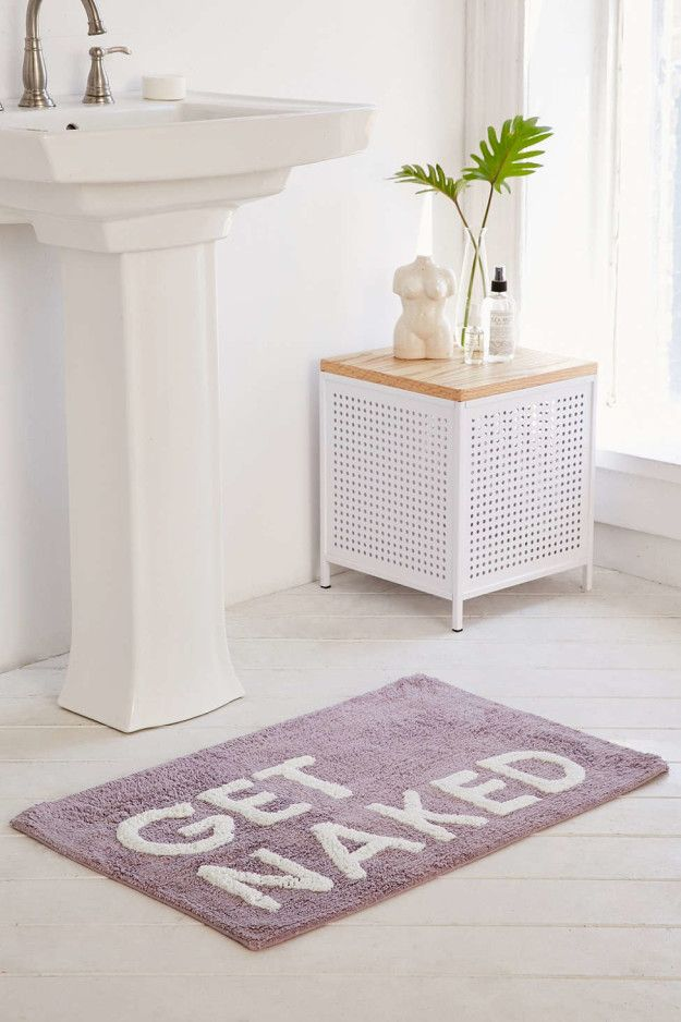 A bath mat that gets right to the point.   14 Totally Adult Ways To Decorate Your New Place Together