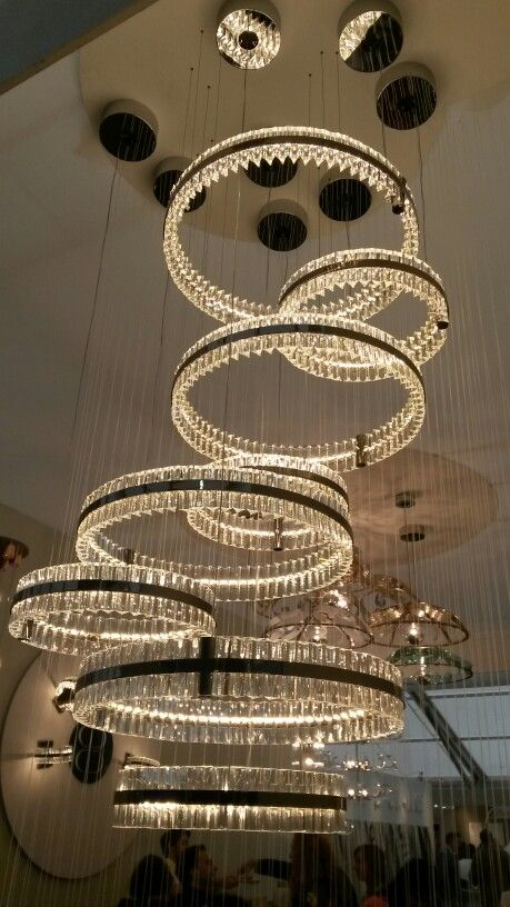 Contemporary chandelier created by grouping several pendants of different sizes. Great effect. #Lighting