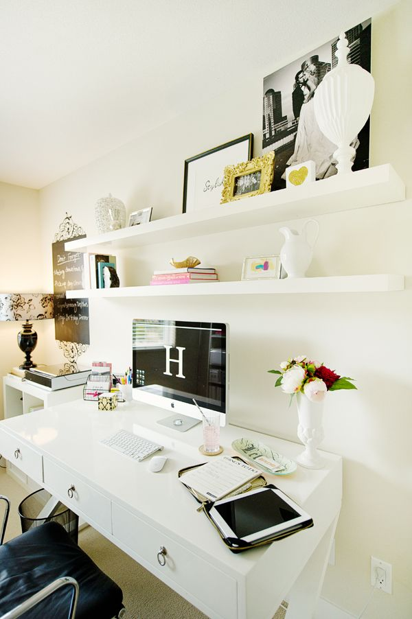 floating shelves, white x-base desk. simple and clean home office.