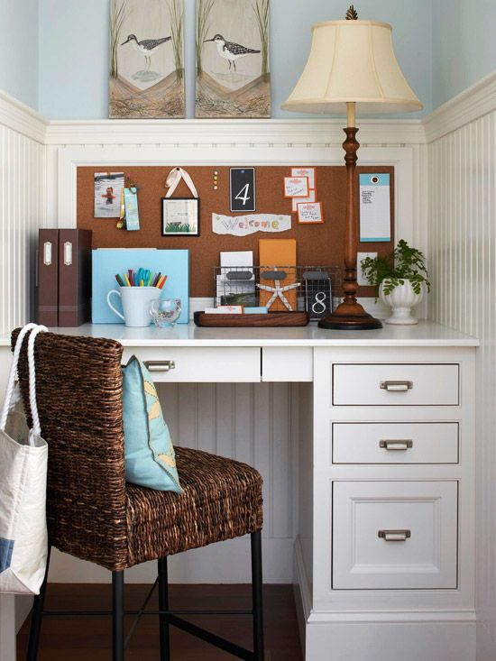 Add a wicker chair and cork board to a white space for a warm but clean atmosphere.