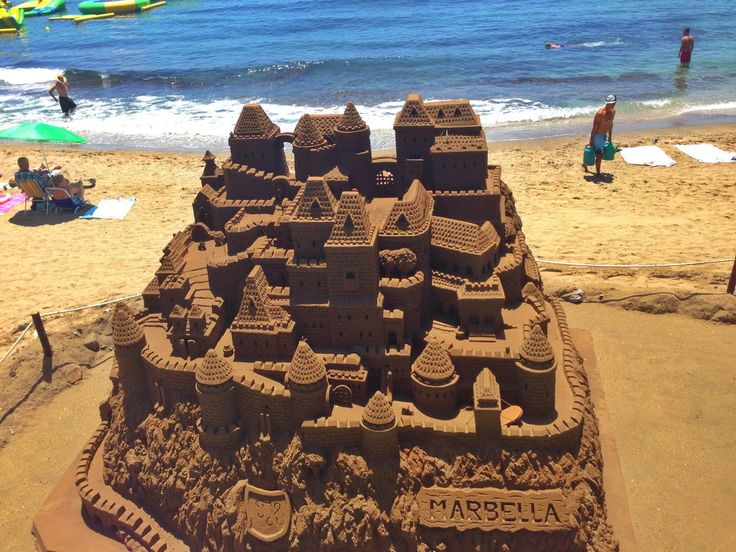 AMAZING SAND SCULPTURE ON BEACH IN MARBELLA - HUGE MULTILEVEL SAND CASTLE!