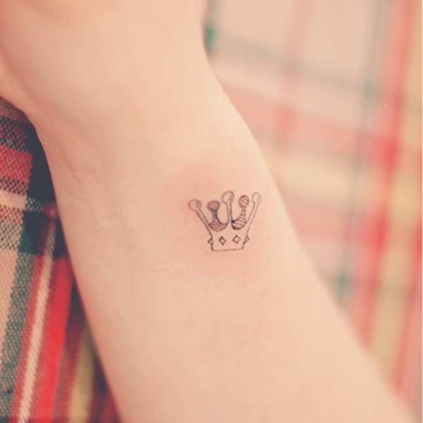 Small crown tattoo on the right inner wrist. Tattoo Artist: Seoeon