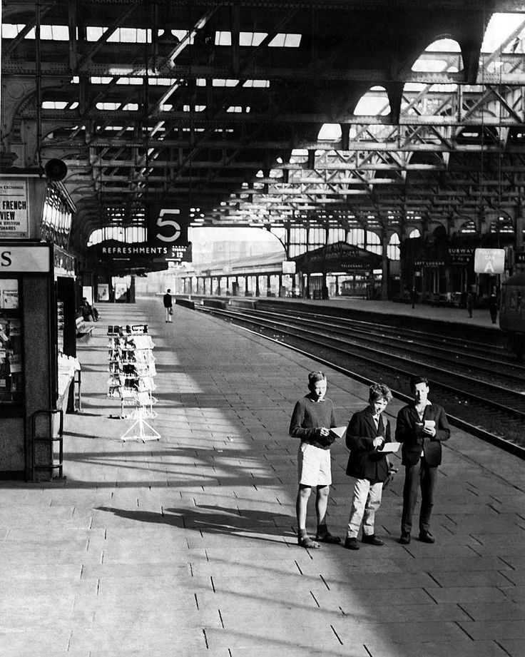 Three young train spotters at a deserted Snow Hill railway station in Birmingham on a bank holiday Monday in 1962.