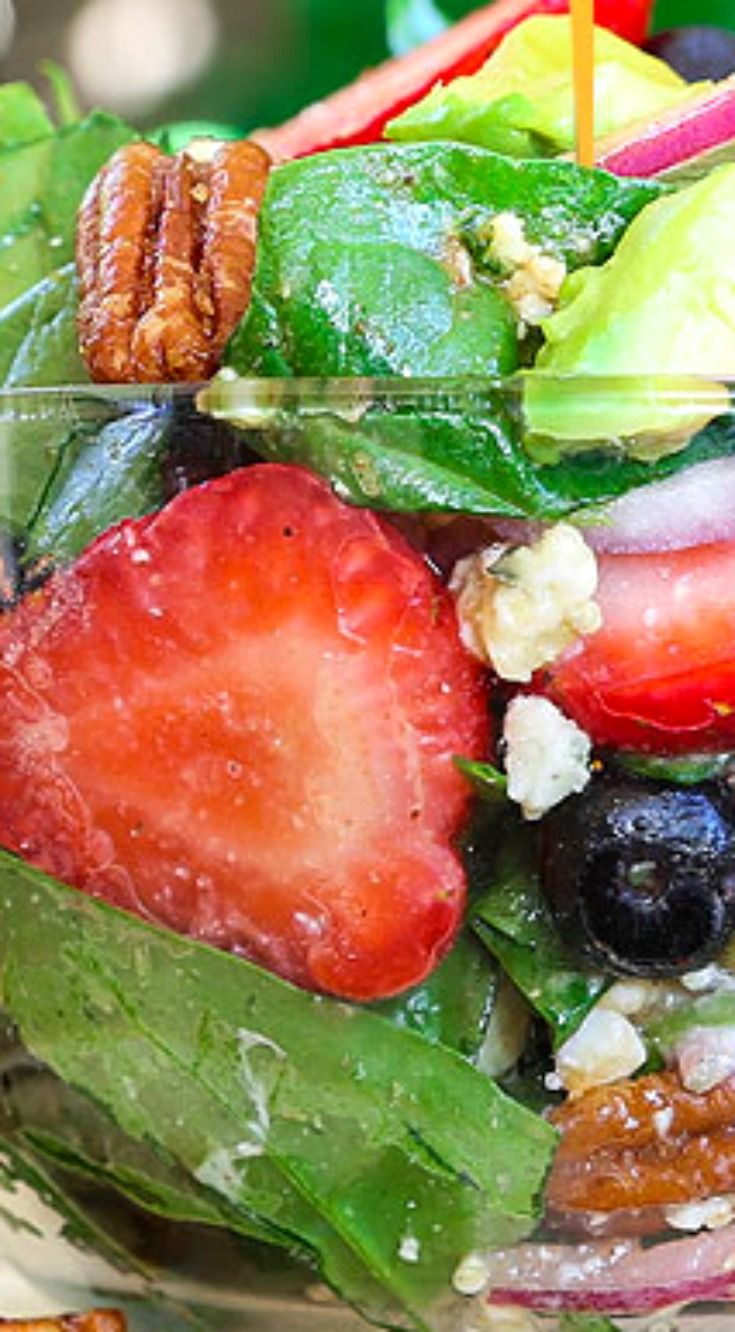 Best Ever Strawberry Spinach Salad (With Video) ~ It will rock your world... Fresh crisp spinach salad is taken to another level with bursts of sweetness from fresh summer fruit and buttery avocado. It is tossed in a sweet and tangy vinaigrette and topped with crunchy nuts and creamy cheese.