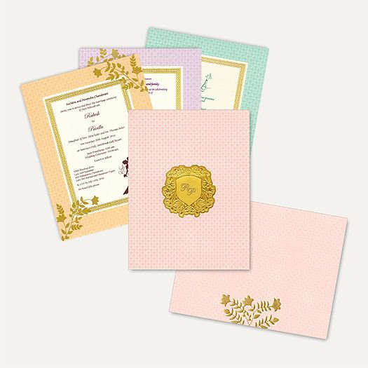The card is made out of Pastel Pink shimmery card board with matching mailing envelope and colourful inserts inside. Card front has gold foil embossed design with floral pattern all around. Gold plated Initials sticker placed in center gives amazing look. Initials can be customizable as per couple's name. #MuslimCards