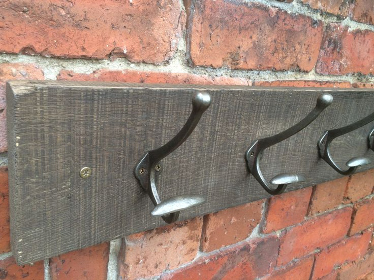 Solid oak reclaimed coat rack with cast iron bowler hooks by RusticRework on Etsy