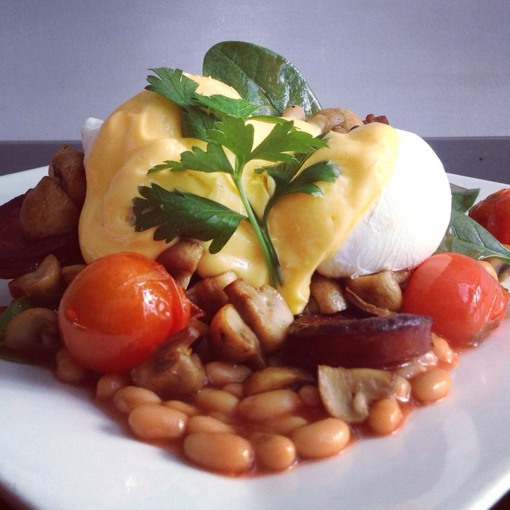 Baked beans and chorizo topped with poached eggs and hollandaise