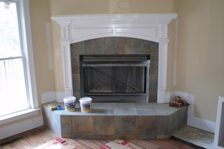 fireplace surround with a slate style porcelain tile custom tile