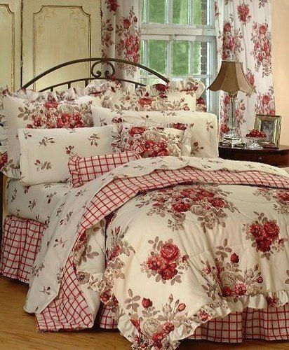 We love the red florals, red gingham, & detailed flower prints in this guest room.......