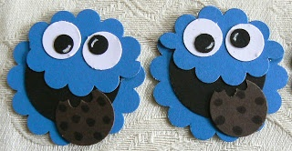 """KBPapercraft; Cookie Monster: head - 1 3/4"""" scallop circle in Pacific point and a second scallop circle punched twice slightly less than half way mouth - 1 1/4"""" circle in black eyes - 1/2"""" circle in white, 1/4"""" circle in black cookie - 3/4"""" circle in early espresso, punched slightly with a scallop to make the """"bites"""" and then the choc chips were drawn on with a black marker"""