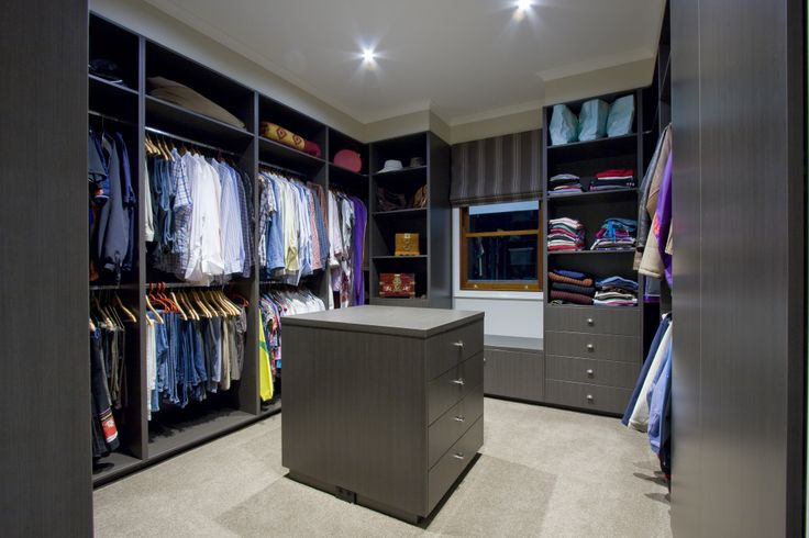 Directly off the ensuite is a celebrity style walk in robe with cabinetry shelving, drawers and an island.