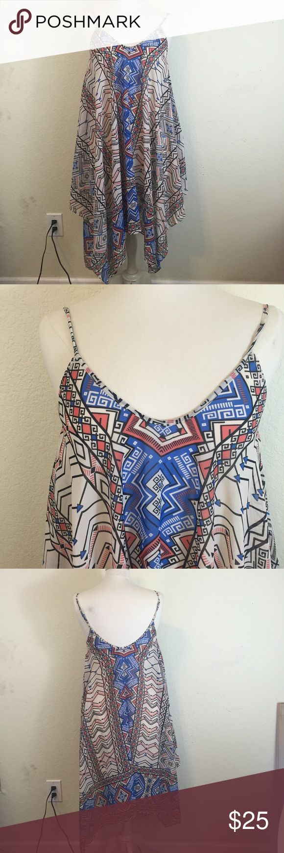 Abstract Print Tunic New! Can be worn as a swim cover up, dress, or tunic. So flowy and fun and easy to wear. Purchased it while on vacation to wear to the pool but ended up not even wearing a coverup. Sizing is pretty accurate- my mannequin is usually a medium and I got this small on but it was snug (only in the chest part- since the rest of this dress is flowy) any fit or sizing questions ask away :) Dresses Asymmetrical